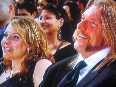 Triple H and his wife Stephanie McMahon chuckle along ...