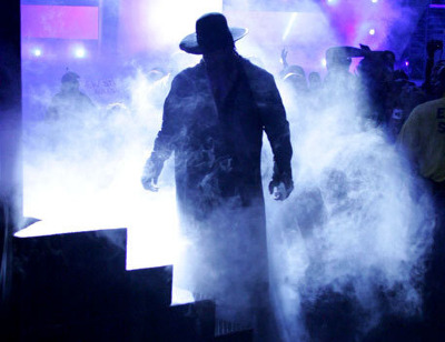 TAKER WORLD CHAMPION AND TAG TEAM CHAMPION Taker